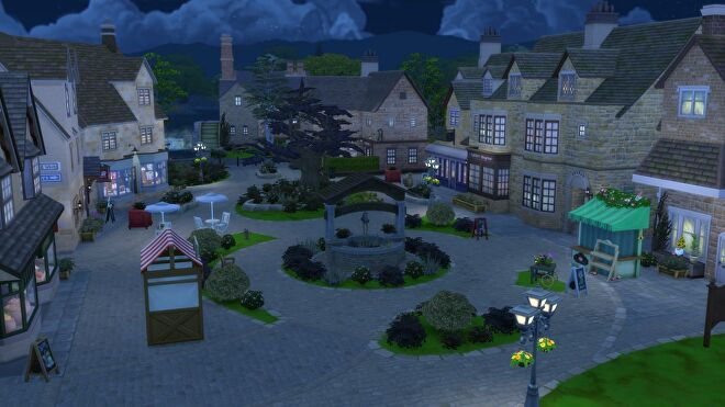 A night time view of the new town in the Sims 4 Cottage Living expansion. It is modelled on idyllic English market towns, like you'd get in Midsomer Murders