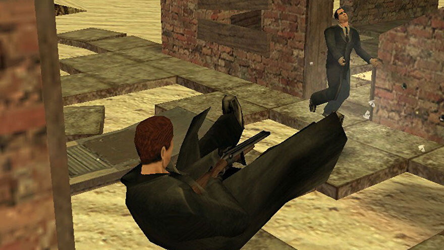 A screenshot of The Specialists mod for Half-Life, showing a trenchcoated Gordon Freeman diving backwards while firing a shotgun towards a dashing G-Man in the distance.