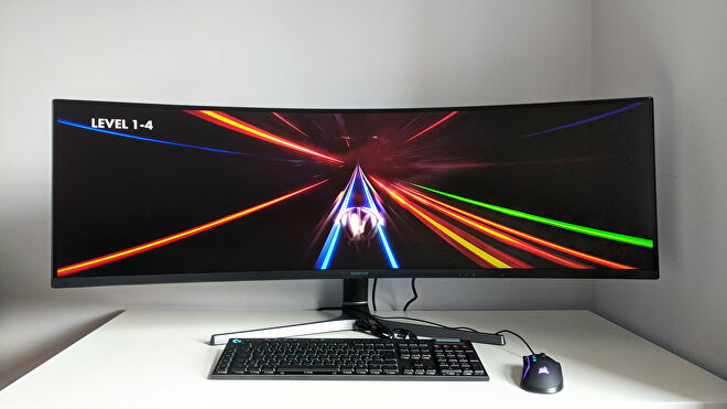 A photo of an ultrawide gaming monitor running Thumper