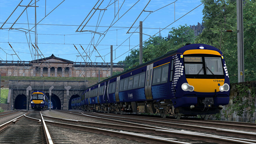A screenshot of two ScotRail trains going through a tunnel as they head to Glasgow Queen Street station