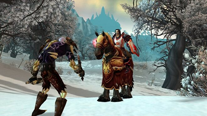 An undead rogue and a human paladin square off on the snow.