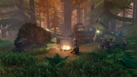 A Valheim screenshot of a player sitting by a firepit next to a Merchant and their cart.