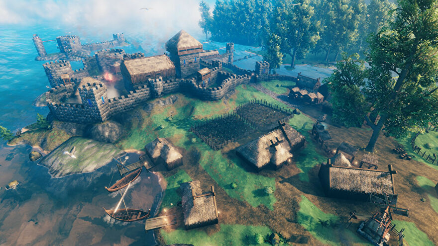 A Valheim screenshot of an extensive settlement with multiple houses, walls, and farms, seen from an aerial perspective.