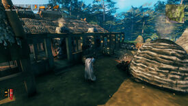 A Valheim screenshot of a player clad in a Wolf Cloak, walking towards the smelting area of a settlement.