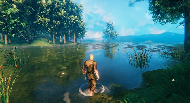 A Valheim screenshot of the player wading into the water and looking out at the sea.