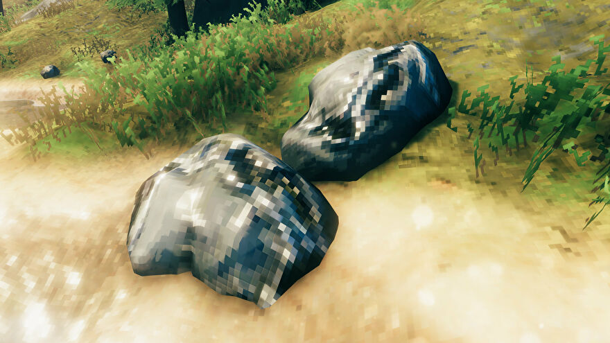 A Valheim screenshot of a pair of Tin Ore deposits close together next to the water.