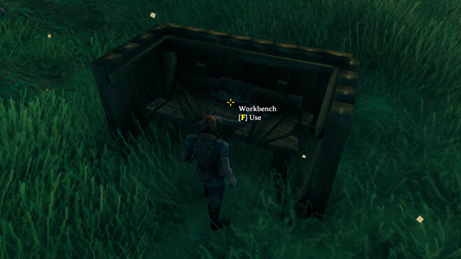 """A Valheim screenshot of a Workbench surrounded by four Wooden Walls in a """"U"""" shape."""