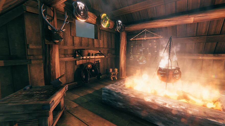 A screenshot of Valheim's Hearth & Home update, showing the inside of a cabin featuring new cooking station items.