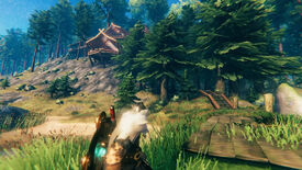 A Valheim screenshot which shows a player looking out at their home perched on the rocks above. A wooden path leads through pine trees towards the entrance.