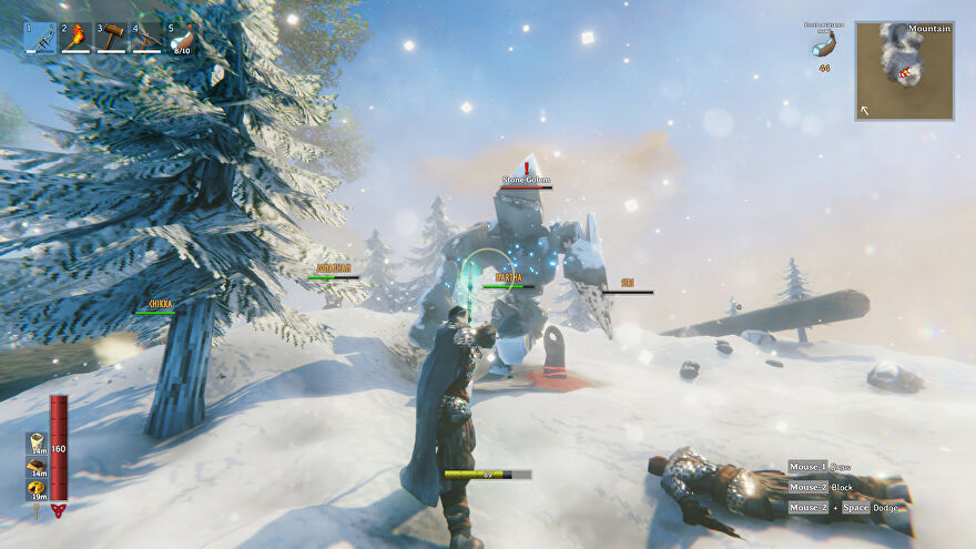 A group of Vikings in Valheim battle against a Stone Golem.