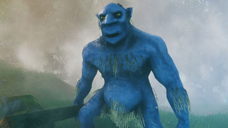 Valheim - An image of the new look for trolls. The large, blue-skinned creature now has grassy chest hair and better muscles.