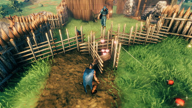 A screenshot from Valheim, which shows a boar impaled on some spikes, yet still alive and happy.