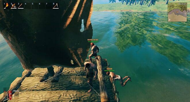 A Valheim screenshot which shows Sigmund swimming into the back of our raft in the hopes of propelling it forwards.
