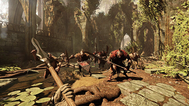The player faces a horde of man-sized rat men in a ruined cathedral in Warhammer: Vermintide 2