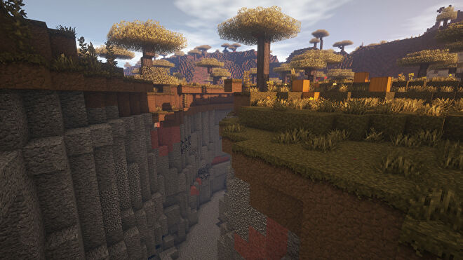 A Minecraft screenshot of a landscape displayed using the Wanderlust Texture Pack.