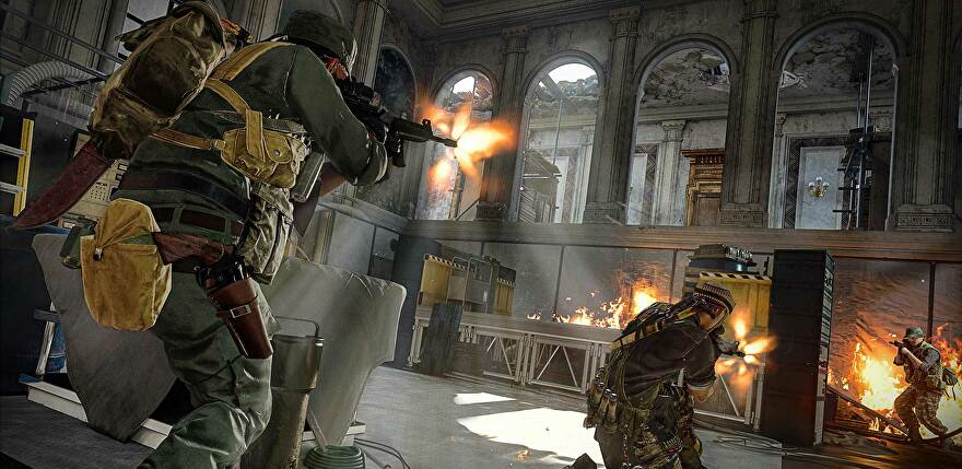 COD operators shoot at each other in an atrium.