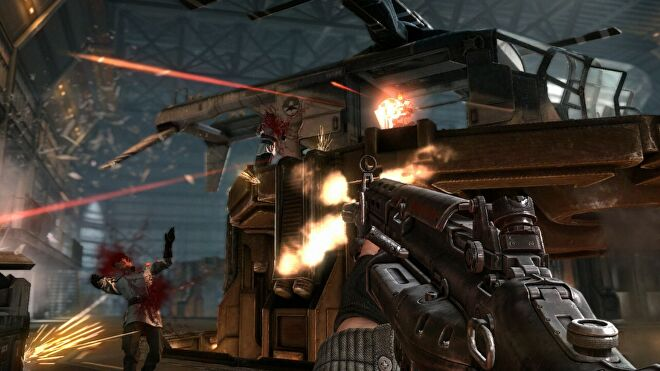 An image from Wolfenstein: The New Order which shows the player shoot an enemy inside a warehouse.