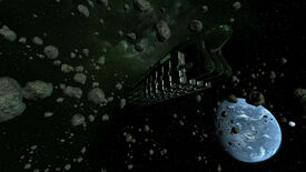 X3: Farnham's Legacy screenshot, showing a long, dark spaceship in an asteroid field, with a planet in the background