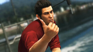 Kazuma Kiryu from Yakuza 6: The Song Of Life giving a thumbs up to the camera while on top of a boat